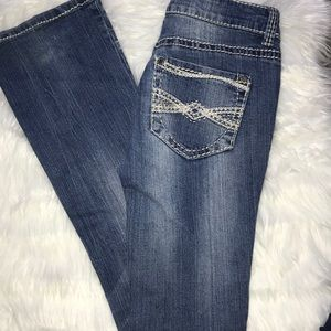 Light wash boot cut jeans with rips